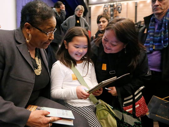 Lynda Blackmon Lowery, left, shares a moment with a young girl and her mother during a pre-Martin Luther King Jr. Day appearance Sunday at the New York Historical Society in New York, where Lowery spoke about her experiences as the youngest participant in the 1965 march from Selma to Montgomery, Alabama.