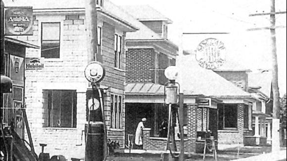 Line of early gasoline pumps within a submitted copy of the Lincoln Highway Garage in Hallam Borough, York Co., PA (This photo has been dated circa 1925 and the building still stands at 278-280 East Market Street in Hallam, PA)