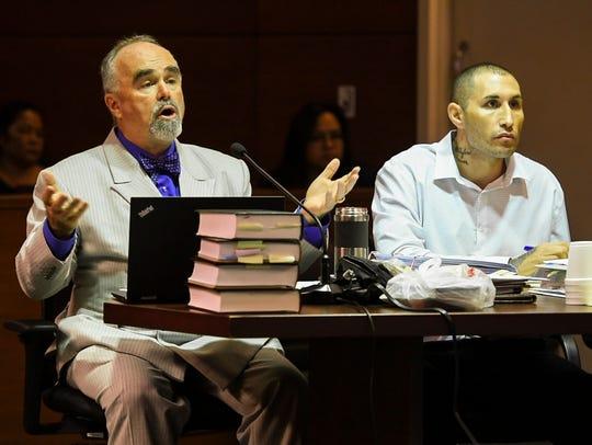 Defense attorney Curtis Van de veld, left, questions