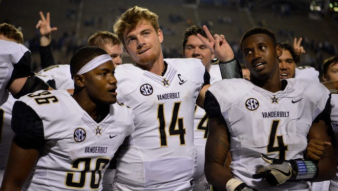 "Vanderbilt wide receiver Trey Ellis (36), quarterback Kyle Shurmur (14) and linebacker Emmanuel Smith (4) sing the alma mater after the 28-6 win over MTSU at Johnny ""Red"" Floyd Stadium in Murfreesboro, Tenn., Saturday, Sept. 2, 2017."