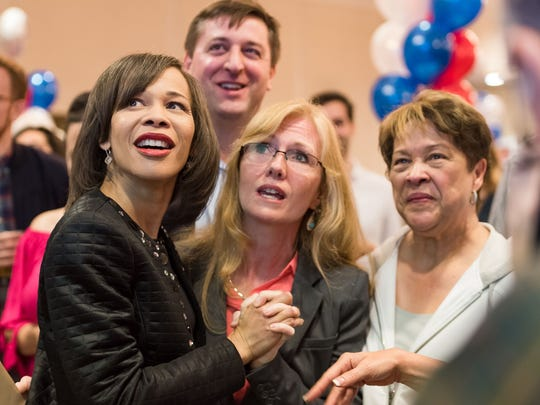Congresswoman Lisa Blunt Rochester, Senator Bryan Townsend, Stephanie Hansen and Senate Majority Leader Margaret Rose Henry react as numbers from the polls come in at a watch party at Odessa Fire Hall.