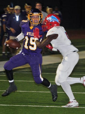 Hirschi's Daimarqua Foster (5) shoves Abilene Wylie quarterback Zach Smith (19) out of bounds. Wylie eliminated Hirschi from the playoffs and plays for the Class 3A Division I state title against Carthage on Friday.