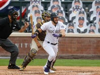 Colorado Rockies' David Dahl, front, breaks from the batter's box after hitting a single next to San Diego Padres catcher Francisco Mejia during the second inning of a baseball game Saturday, Aug. 1, 2020, in Denver. (AP Photo/David Zalubowski)