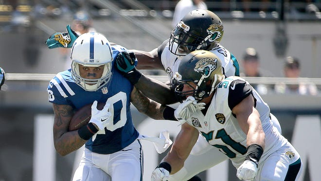 Indianapolis Colts WR Donte Moncrief makes a catch and runs away from Jacksonville Jaguars Chis Clemons and Paul Posluszny, right, in the second half Sunday.