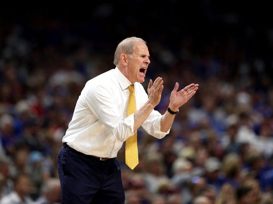 Michigan head coach John Beilein encourages his team