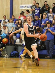 Dayton's Tanner Lewis drives to the basket against Amity on Monday, Jan. 29, 2018.