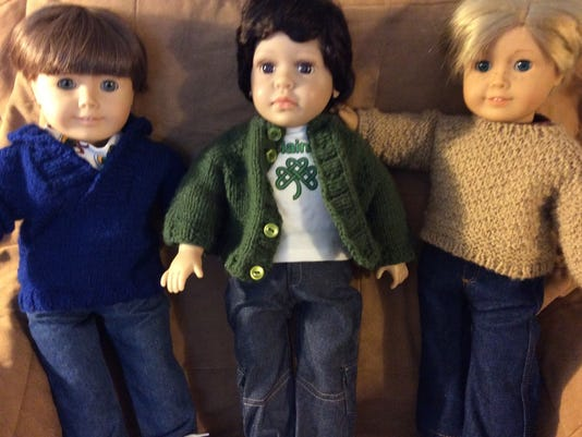 My two AG boy dolls seemed very pleased with their new brother, Mason, when he arrived in the snow storm yesterday.