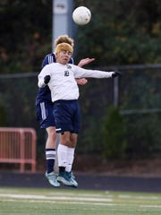 Stayton's Ivan Navarro heads the ball as the Eagles defeat Henley 2-1 in the semifinals of the OSAA Class 4A state playoffs on Tuesday, Nov. 10, 2015, at Sprague High School.