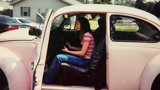 Reporter Leigh Guidry was surprised with her first car, a 1974 Volkswagen Beetle that had been her cousin's, on her 15th birthday in 2002. Tell us about your first car! Send photos and answers to a few questions to lguidry@theadvertiser.com to add to our gallery.