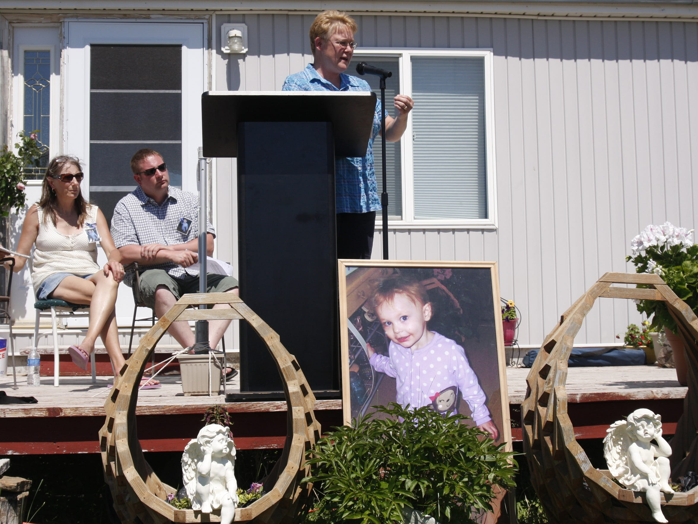 The Blaine County superintendent of schools Lisa Stroh speaks at the October Perez memorial and child-abuse prevention rally as Perezs father Michael Arndt and Grandmother April Hall listen Sunday.