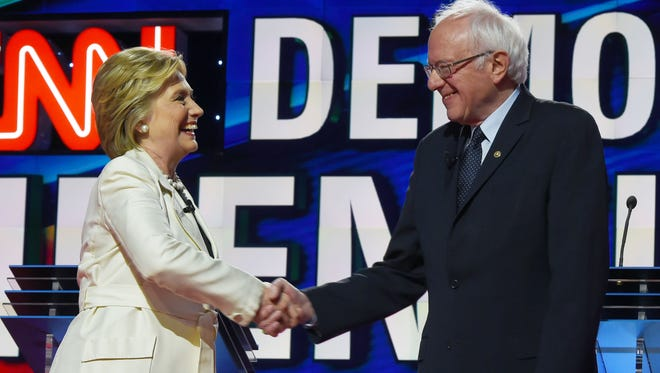 US Democratic presidential candidates Hillary Clinton (L) and Bernie Sanders shake hands before the CNN Democratic Presidential Debate at the Brooklyn Navy Yar on April 14, 2016, in New York. In her latest speech, Clinton pushed for core progressive proposals, some inspired or pushed along by Bernie Sanders' campaign. The Democratic Party platform, meanwhile, is being called the most progressive in history.