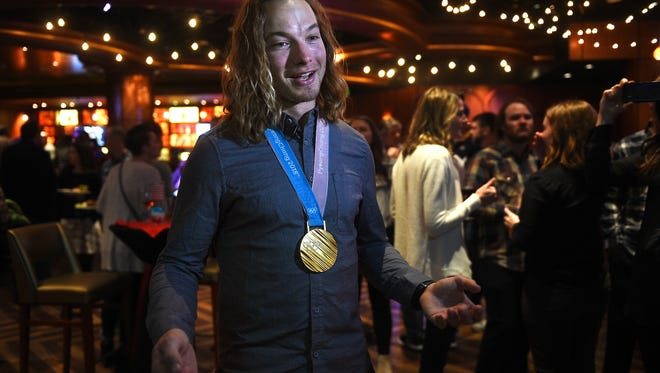 Olympic champion and Reno local David Wise sports his gold medal during a private party in his honor at NoVi in the Eldorado Hotel and Casino on March 3, 2018.
