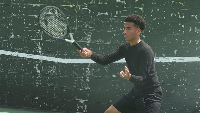 Aaron Jackson of Opelousas High attempts an overhead as he approaches the net on Thursday during the 13th annual Opelousas High Tennis Tournament held at South City Park.