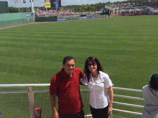 Barbara Rodriguez, of baseball bat company Carrera Sports, right, with Cuban director of baseball Heriberto Suarez. She wants Carrera Sports to be able to supply bats to the Cuban baseball program.