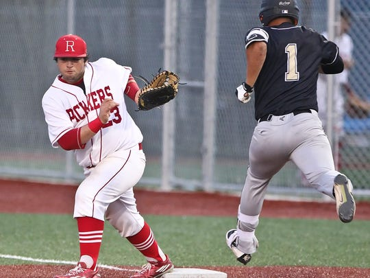 Robstown first baseman Marco De Los Santos (23) make makes a catch in a playoff series against Kingsville last season. The Cotton Pickers and Brahmas are two teams that could challenge for the title in District 31-4A.