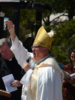 Bishop Frank DeWane speaks at the groundbreaking at St. John the Evangelist Catholic Church.