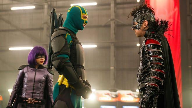 Hit-Girl (Chloe Grace Moretz), left, and Kick-Ass (Aaron Taylor-Johnson) face off against the world's first supervillain (Christopher Mintz-Plasse) in 'Kick-Ass 2.'