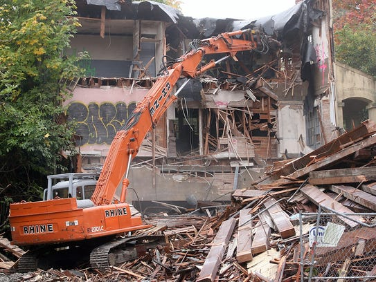 Machinery demolishes the historic Moran School on Bainbridge Island on Thursday. The city issued a demolition permit in July.