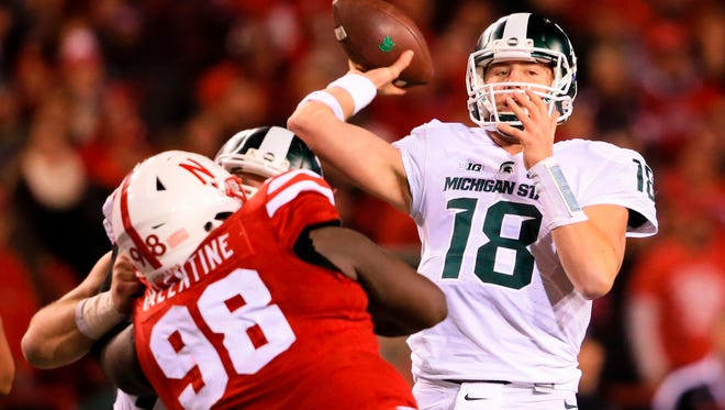 Michigan State quarterback Connor Cook completed 23 of 37 passes for 335 yards and four touchdowns in MSU's 39-38 loss Saturday night at Nebraska. He also converted eight straight third downs through the air. Still, with the game on the line, MSU elected to run the ball and roll with its defense.
