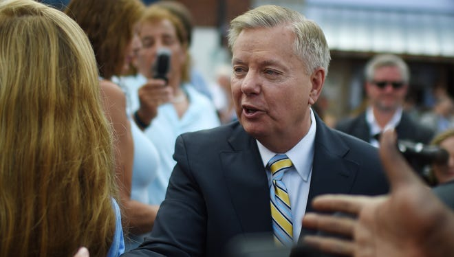 Republican presidential candidate, Sen. Lindsey Graham, R-S.C., greets supporters in Central, S.C.