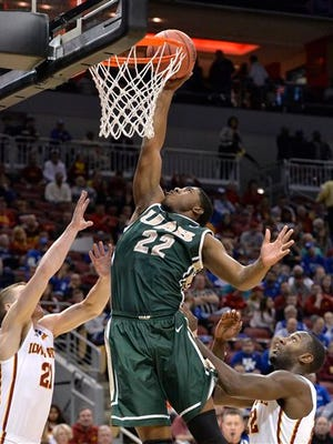 UAB's Tyler Madison, center, goes up for a shot past the defense of Iowa State's Matt Thomas, left, and Dustin Hogue during the first half of a second round game in the NCAA college basketball tournament in Louisville, Ky., Thursday, March 19, 2015.  (AP Photo/Timothy D. Easley)