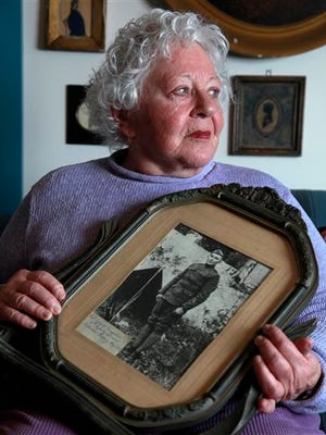 FILE - In this Jan. 5, 2012 file photo, Elsie Shemin-Roth holds a World War I photo of her father, William Shemin, at her home in Labadie, Mo. Nearly a century after Sgt. Shemin pulled wounded comrades to safety on a World War I battlefield, his heroism has finally earned him the nation's highest service medal. On Thursday, May 14, 2015, the White House announced that President Barack Obama will award the Medal of Honor in tribute to Roth. He died in 1973. (AP Photo/Jeff Roberson, File)