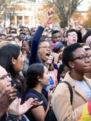 FILE - In this Nov. 9, 2015, file photo, Yale University students and faculty rally to demand that Yale University become more inclusive to all students on Cross Campus in New Haven, Conn. At schools including Michigan and Yale, students say the protests that led to the resignation of Missouri President Tim Wolfe are emboldening them to take a harder line.