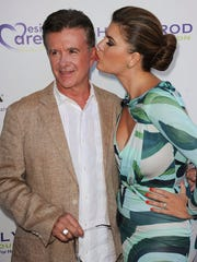 FILE - In this Saturday, July 27, 2013 file photo, Alan Thicke, left, and his wife, Tanya Callau, arrive at the 15th Annual DesignCare in Malibu, Calif. On Tuesday, Dec. 13, 2016, a publicist said Thicke has died at the age of 69.