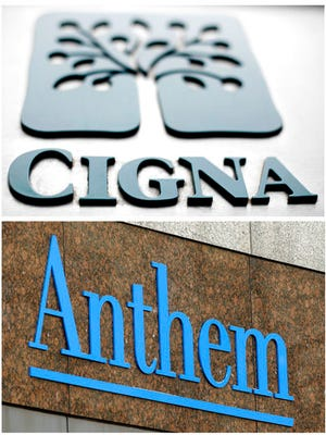 This combo of file photos shows signage for health insurers Cigna Corp., and Anthem Inc.  A federal appeals court on Friday, April 28, 2017, left in place a decision blocking Blue Cross-Blue Shield insurer Anthem's bid to buy rival Cigna, saying that a bigger company is not better for consumers. The 2-1 decision upholds a federal judge's ruling in February that said the proposed $48 billion acquisition would reduce competition in the concentrated insurance market.
