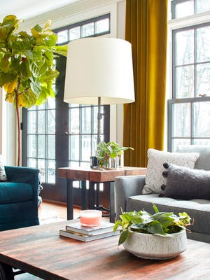 This photo provided by Jared Kuzia Photography shows how graceful fiddlefig trees with broad, glossy leaves have become extremely popular among homeowners, says interior designer Kristina Crestin, who used one in designing this living room shown here in Essex, Mass. Plants can be the perfect final touch that brings warmth and beauty to a room without over-accessorizing, says Crestin.
