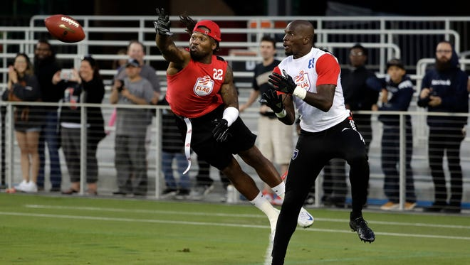 Omar Bolden, left, breaks up a pass intended for Chad Johnson during a flag football exhibition game last week in San Jose, Calif. The American Flag Football League is relying on older stars like Johnson to get fans interested.