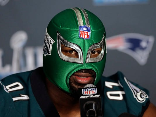Philadelphia Eagles defensive tackle Fletcher Cox wears a wrestling mask as he takes part in a media availability for the NFL Super Bowl 52 football game Wednesday, Jan. 31, 2018, in Minneapolis. Philadelphia is scheduled to face the New England Patriots Sunday. (AP Photo/Eric Gay)
