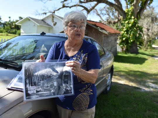 Ruth Stanbridge, Indian River County historian, displays a photo of the old T. M. Jones fruit stand while discussing the future of the Jones property at 7770 Jungle Trail on Wednesday, June 27, 2018, in Indian River County. The fruit stand is behind Stanbridge on the right. The Jones property is part of the history of the Jungle Trail, an 8-mile dirt road built in the 1920s north of Vero Beach and is on the National Register of Historic Places.