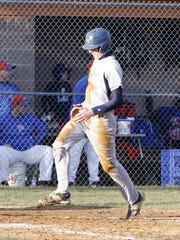 Matt Smith scores a run for Elmira Notre Dame against