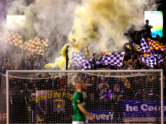 Louisville City FC fans cheer on their team in a game against St. Louis FC.
