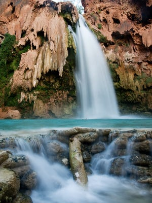 HAVASU FALLS: Water flows from Havasu Falls, one of the Havasupai waterfalls that draw campers from around the world.