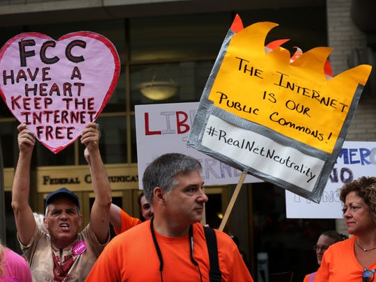 Demonstrators, protest outside Federal Communications