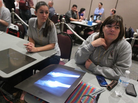 """""""It's important to talk about different ways to identify an individual,"""" said Dr. Laura Fulginiti of the Maricopa County Medical Examiner's Office. She attended the Missing in Arizona Day event Nov. 5, 2016, to help take medical records for cases."""
