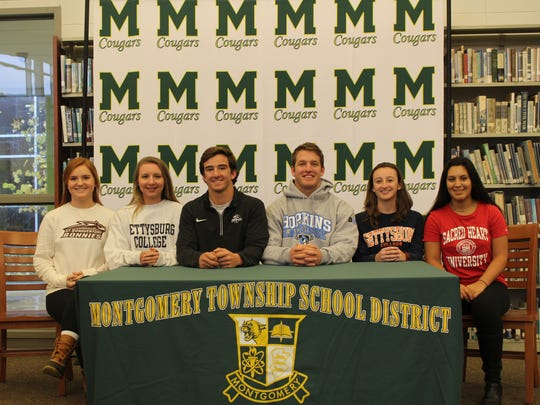 (From left to right) Montgomery's Shannon Curry, Sara Howard, Zachary Masessa, Jared Reinson, Maeve Dwyer and Kira Ferraiolo sign their National Letters of Intent.
