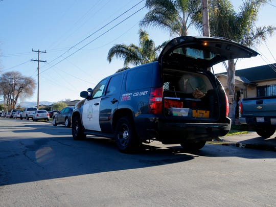 A Salinas police CSI unit parks outside a Sunrise Street