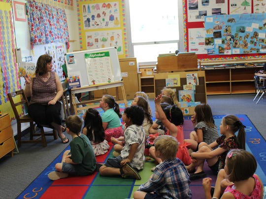 Londa Hart hosts story time with her students after
