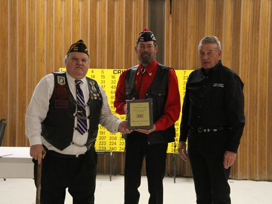 Otero County Crime Stoppers presented an award to VFW Post 7686 Post Junior Vice Commander Roy Powers (L) and Post Commander Warren G. Booker (M) by Crime Stoppers Board President Jim Lynch (R) for their continued support for Crime Stoppers Saturday.