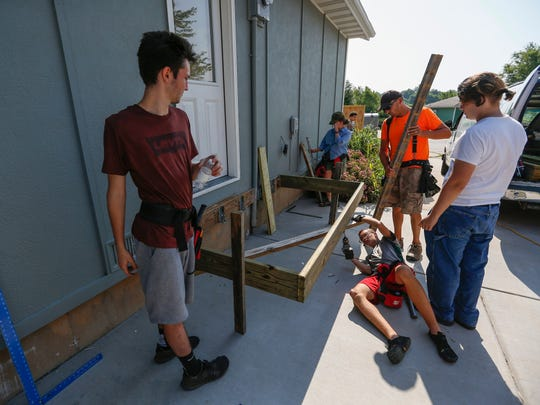 SPS students help build a deck at the Habitat for Humanity site at Legacy Court on Friday, June 15, 2018.