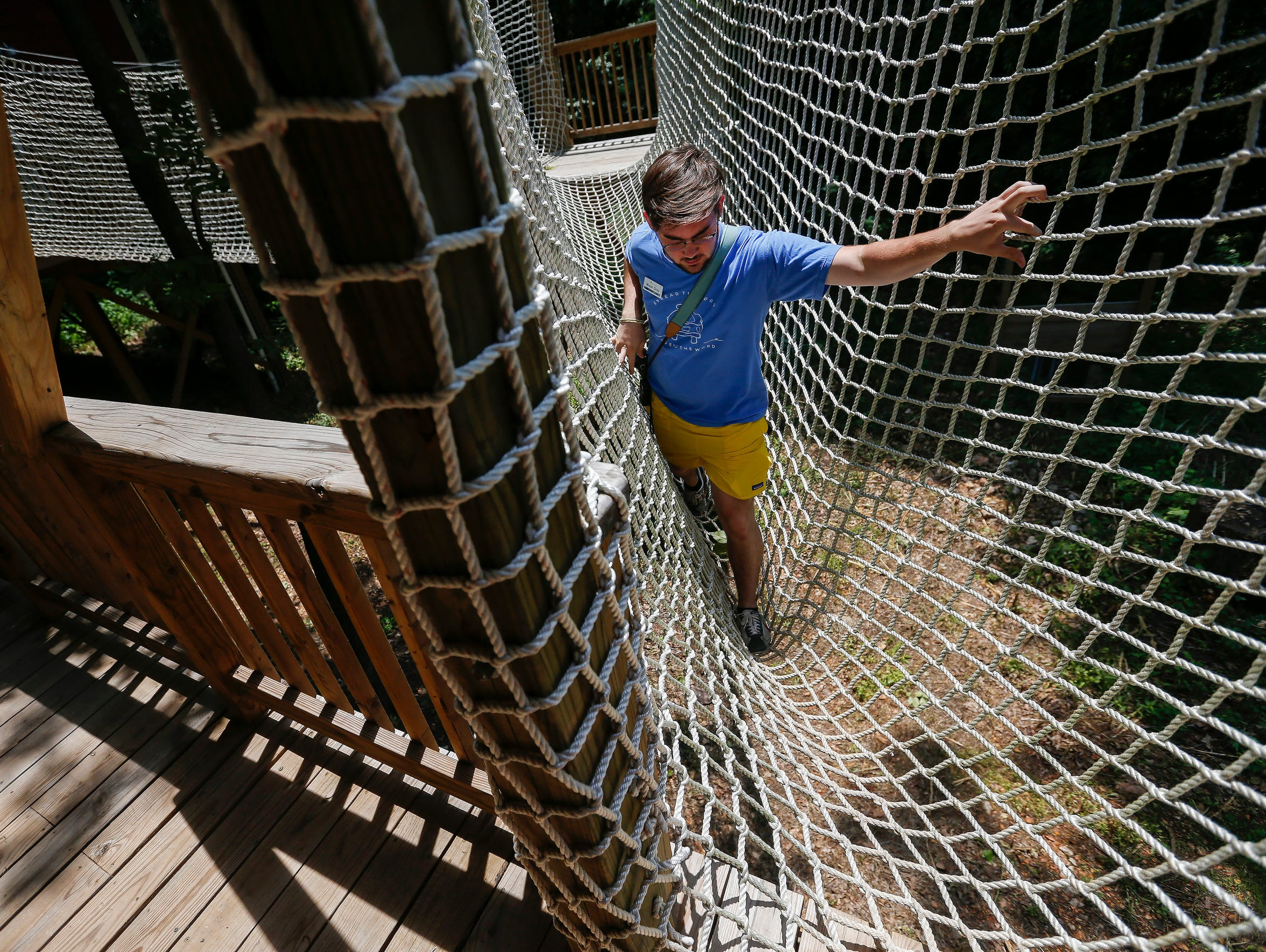 Techie leader Micah Gray crosses over the rope bridge