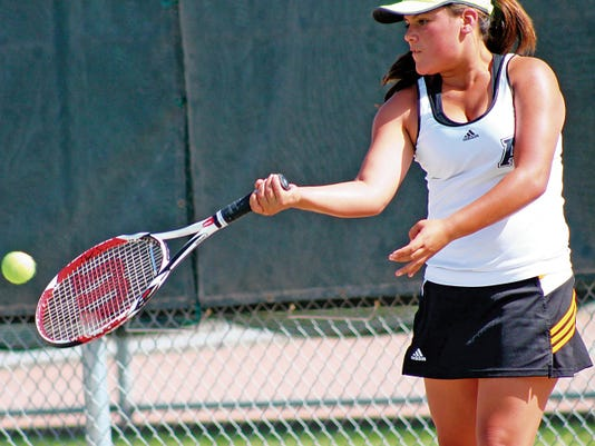 Peter Dindinger — Daily News Elisa Mercado returns a forehand Tuesday afternoon at the Oregon Courts.