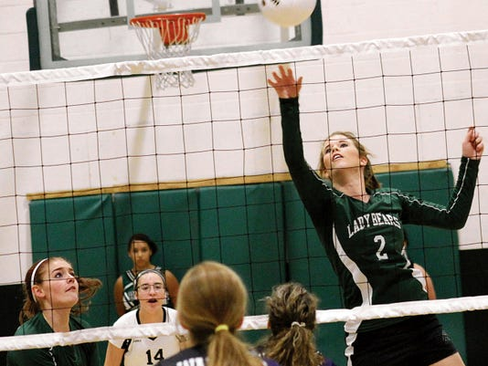 KaiDawn Bowman tips a ball over the net Tuesday night at the Cloudcroft High School gym.