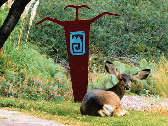 """Courtesy Photo   Mark Bowen's metal art """"Shaman"""" is shown as it is used in an outdoor setting. Evidently Mark's creative works are also appreciated by the New Mexico wildlife."""