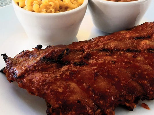 The smoked pork ribs ($14) are dry-rubbed with house chipotle BBQ sauce and served with a side of baked beans and mac and cheese. In April, De La Vega's made some changes to their menu, including new entree options.