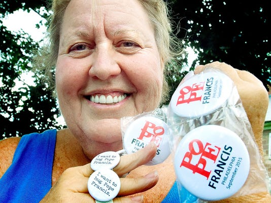 Arlette Figdore displays some of the Pope Francis buttons she owns outside her Conewago Township home. She is planning to attend Pope Francis' appearance in Philadelphia this weekend. See Figdore in a video at www.yorkdispatch.com.