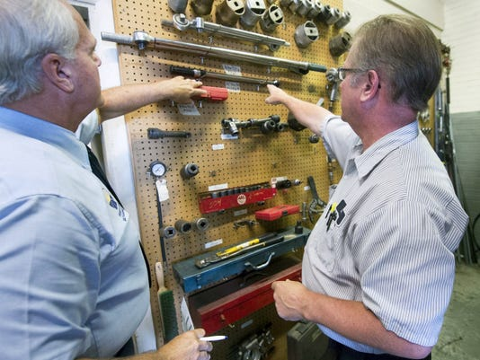 Greg Stone, a quality assurance officer for the state, left, with Marvin Heath, a PennDOT mechanic supervisor, checks to see the tool room has the proper equipment for vehicle inspections during a surprise audit at a PennDOT facility in Manchester Township on Tuesday. The station, which does safety inspections, was found to be in compliance.